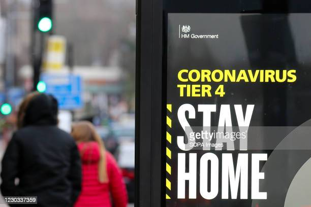 Stay Home' sign seen in London as many parts of the UK are now in Tier 4 COVID-19 restrictions. The UK has recorded its highest daily rise in...