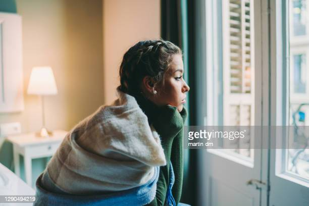 stay home, stay safe during covid-19 pandemic - one young woman only stock pictures, royalty-free photos & images