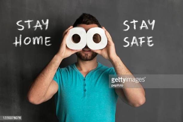 resta a casa, stai al sicuro - emorroidi foto e immagini stock