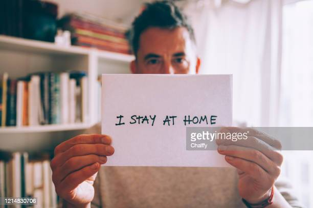 stay home,stay safe - placard stock pictures, royalty-free photos & images