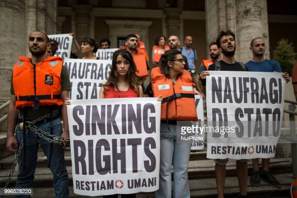 'Stay Human' activists stage a protest outside the Ministry of Transport in Rome on July 11 2018 Dozens of 'We remain human' network activists...