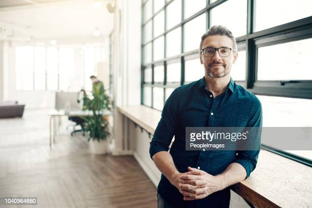 stay hungry for success - man in office stock photos and pictures