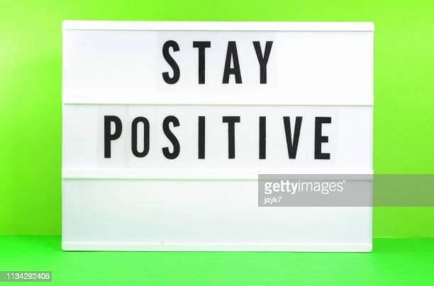stay positive - lightbox stock pictures, royalty-free photos & images