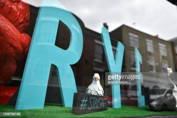 "Stay Safe"" message is displayed in a shop window in Rye in southern England on April 13 as life in Britain continues over the Easter weekend, during..."