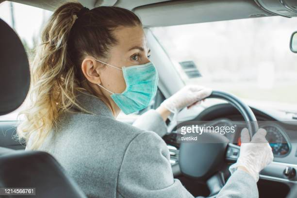 stay safe - driving mask stock pictures, royalty-free photos & images