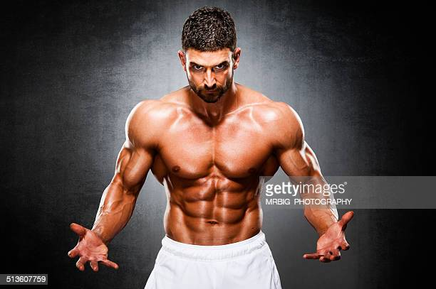 stay strong - handsome bodybuilders stock photos and pictures