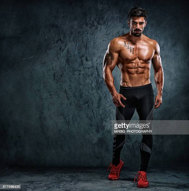 stay strong - male torso stock photos and pictures