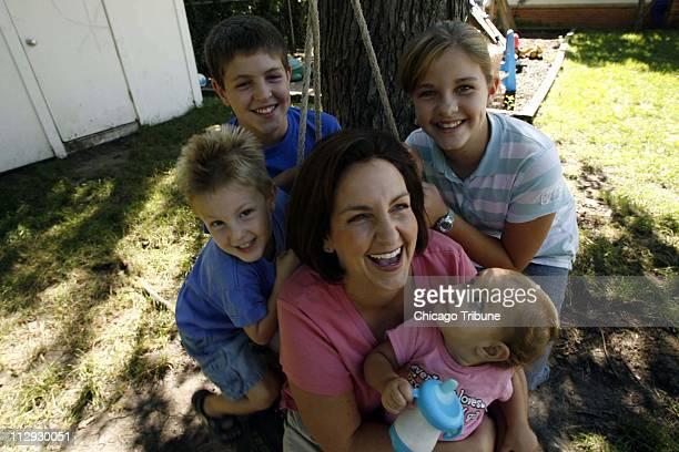 Stayathome mom Dawn Meehan enjoys her children Clayton Austin Savannah and Brooklyn outside her Elk Grove Village Illinois home Thursday August 31...