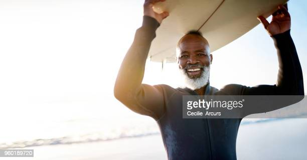 staying active keeps the spirit young - surf stock pictures, royalty-free photos & images