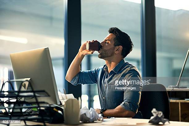 staying awake at work with a caffeine boost - caffeine stock pictures, royalty-free photos & images
