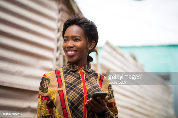 staying connected in the townships - black alley stock photos and pictures