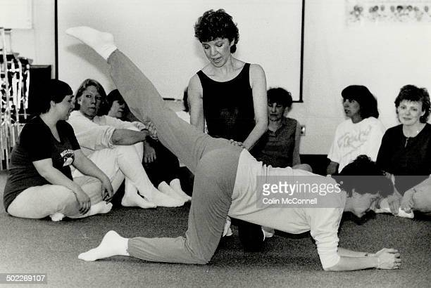 Staying fit Fitness instructor Lynne Berlin demonstrates an exercise at a class for expectant moms Doctors now encourage pregnant women to stay...