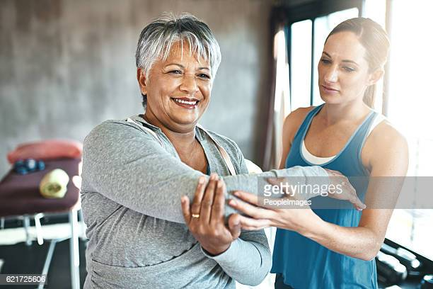 staying fit improves her health and outlook on life - osteoporosis stock photos and pictures