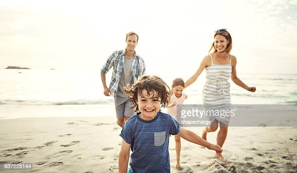 staying fit through play - beach photos stock photos and pictures