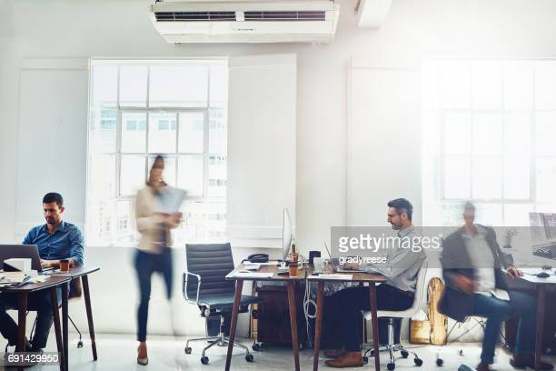 staying focused in a fast paced business - motion blur stock photos and pictures