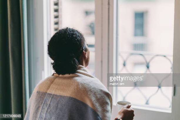 staying home during covid-19 pandemic - looking at view stock pictures, royalty-free photos & images