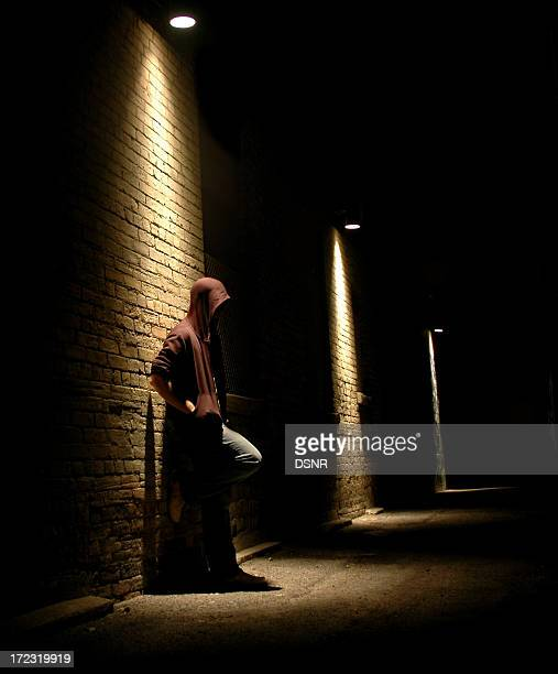 staying in the light - black alley stock photos and pictures