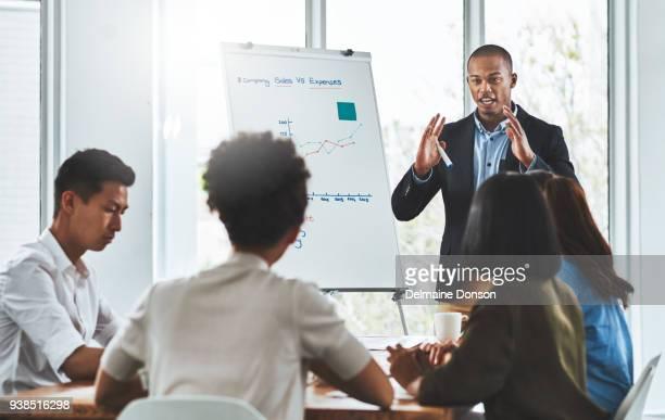 staying on top of company performance with regular review meetings - congresso organizações imagens e fotografias de stock