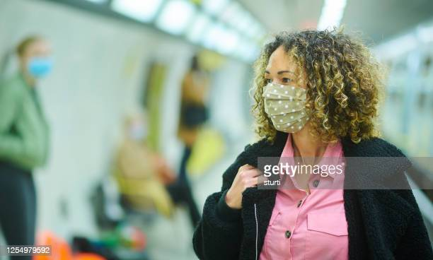 staying safe on the underground - sturti stock pictures, royalty-free photos & images