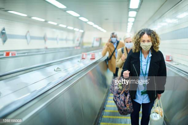 staying safe on the underground - uk stock pictures, royalty-free photos & images