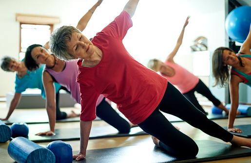 Staying supple in her senior years with pilates 513948032