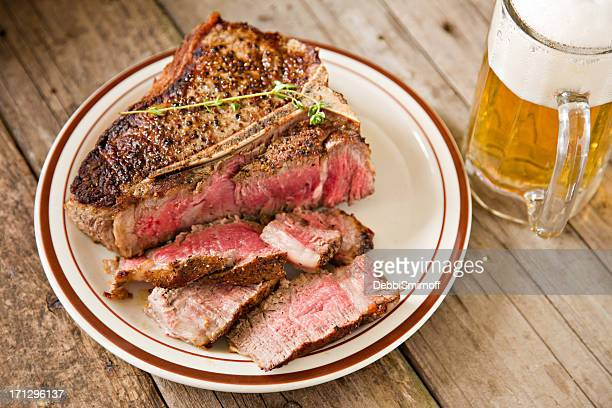 steak and a beer - beer stein stock photos and pictures