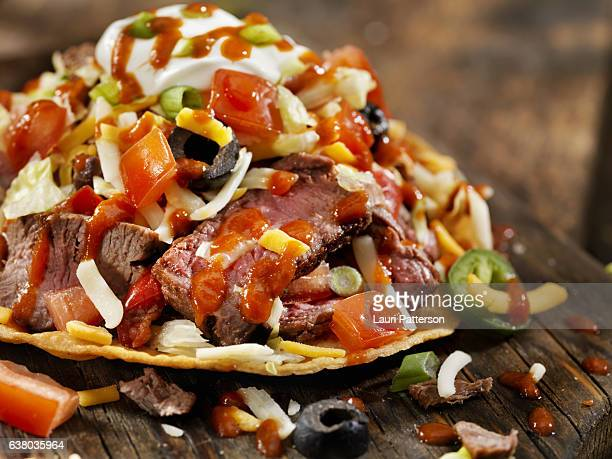 Steak and Cheese Tostada with Hot Sauce