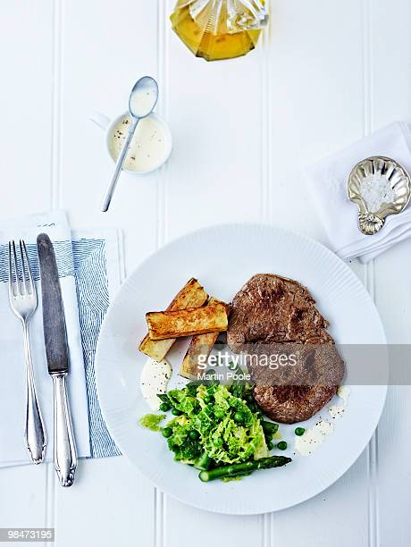 steak and chips on plate overhead