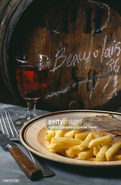 Steak and french fries with Beaujolais nouveau