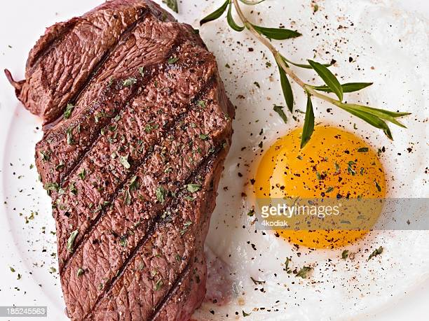 steak and sunny side up egg with seasoning - steak stock pictures, royalty-free photos & images