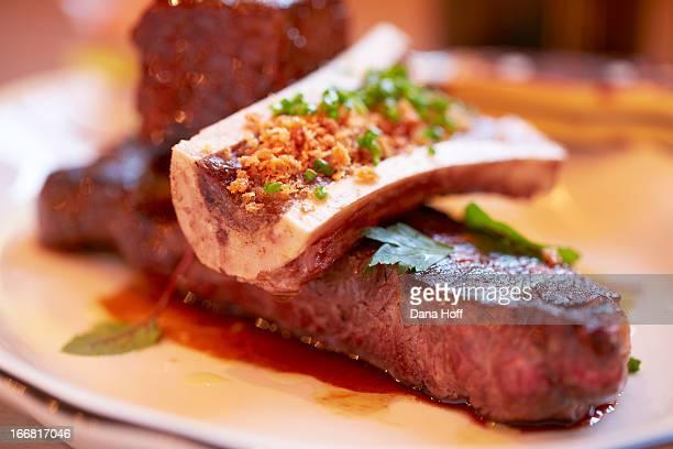 steak dinner with bone marrow on plate