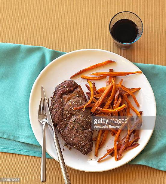 Steak Entree with Sweet Potato Fries on Plate