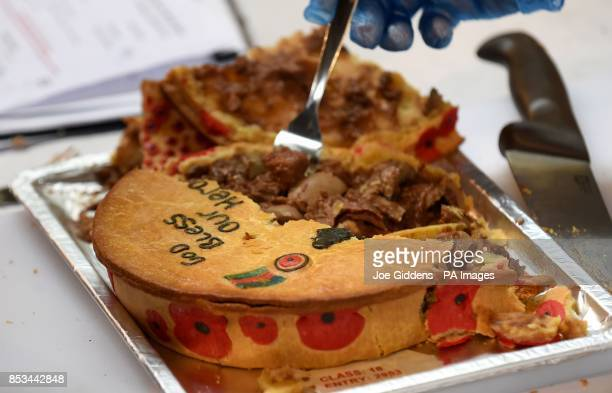 A steak kidney and onion pie is judged as part of the Fit for a Hero category during the British Pie Awards 2014 at St Mary's Church Melton Mowbray