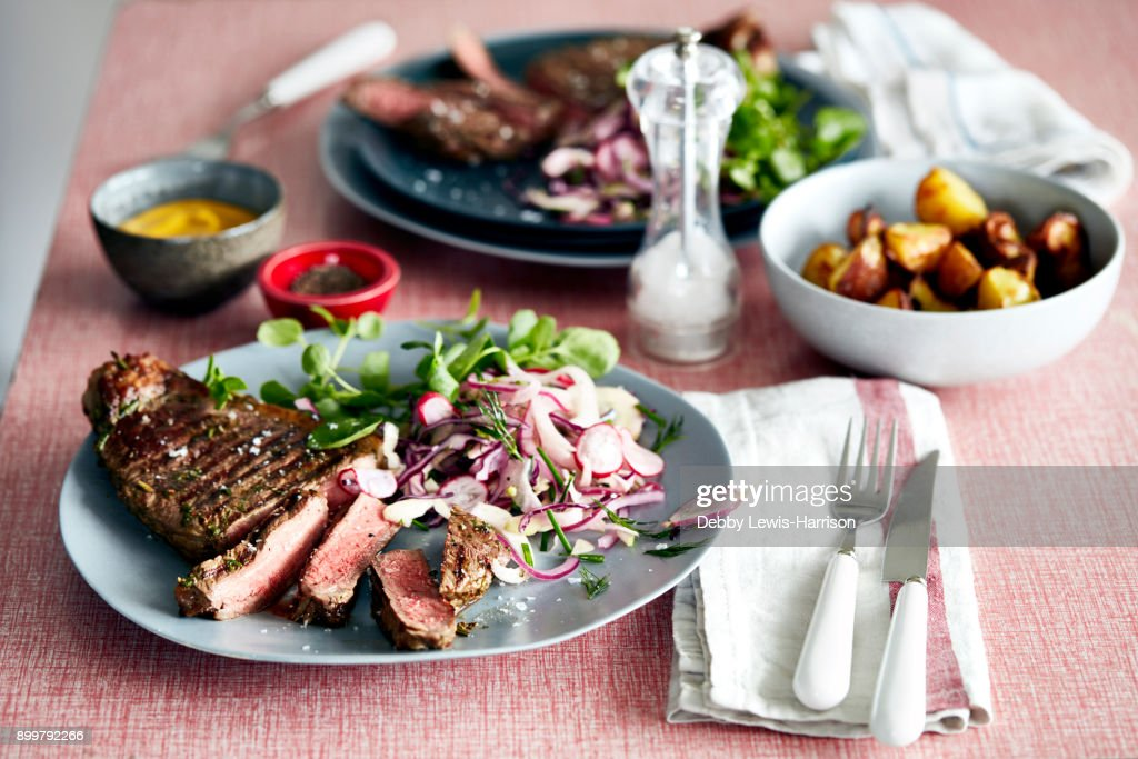 Steak meal for two on table : Stock Photo