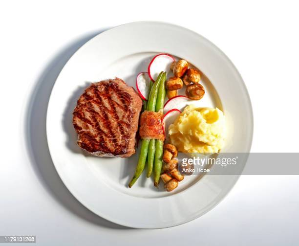 steak on white background - plate stock pictures, royalty-free photos & images