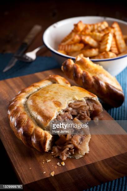 steak pasty with homemade chips - cornish pasty stock pictures, royalty-free photos & images
