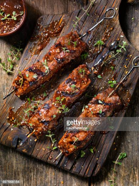 bbq steak skewers - barbeque sauce stock photos and pictures