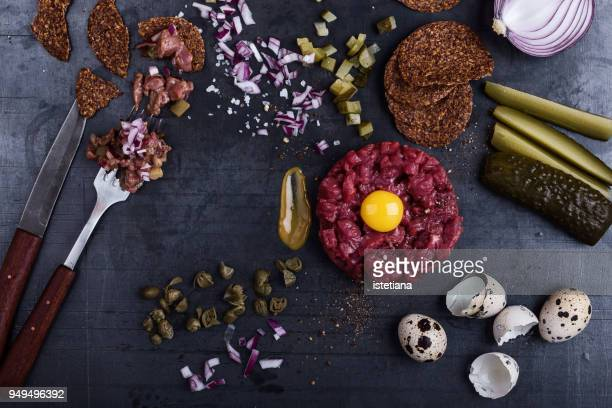steak tartare preparation - sliced pickles stock photos and pictures