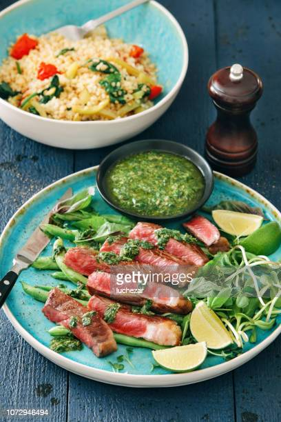 steak with chimichurri sauce, vegetables, herbs and bulgur salad - carne de churrasco imagens e fotografias de stock