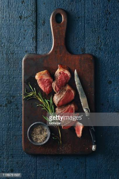 steak with creamy mushroom sauce steak with creamy mushroom sauce steak with creamy mushroom sauce steak with creamy mushroom sauce - chopping board stock pictures, royalty-free photos & images