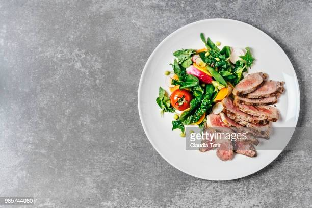 steak with fresh salad - red meat stock pictures, royalty-free photos & images
