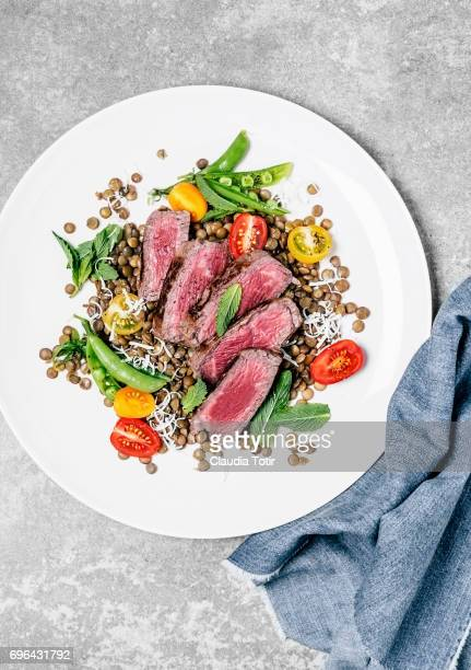 Steak with lentils, sugar snap peas, and cherry tomatoes