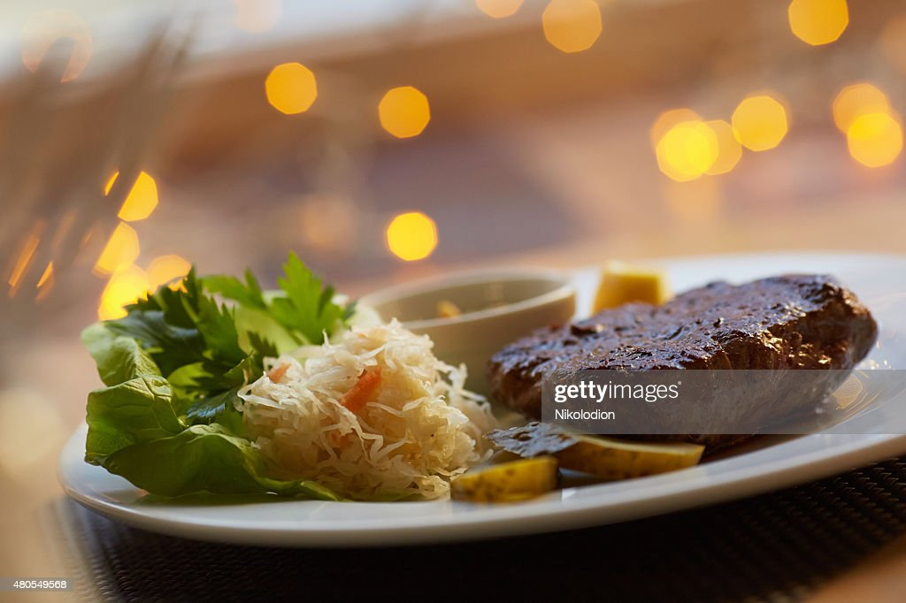 steak with sauce and vegetables : Stock Photo