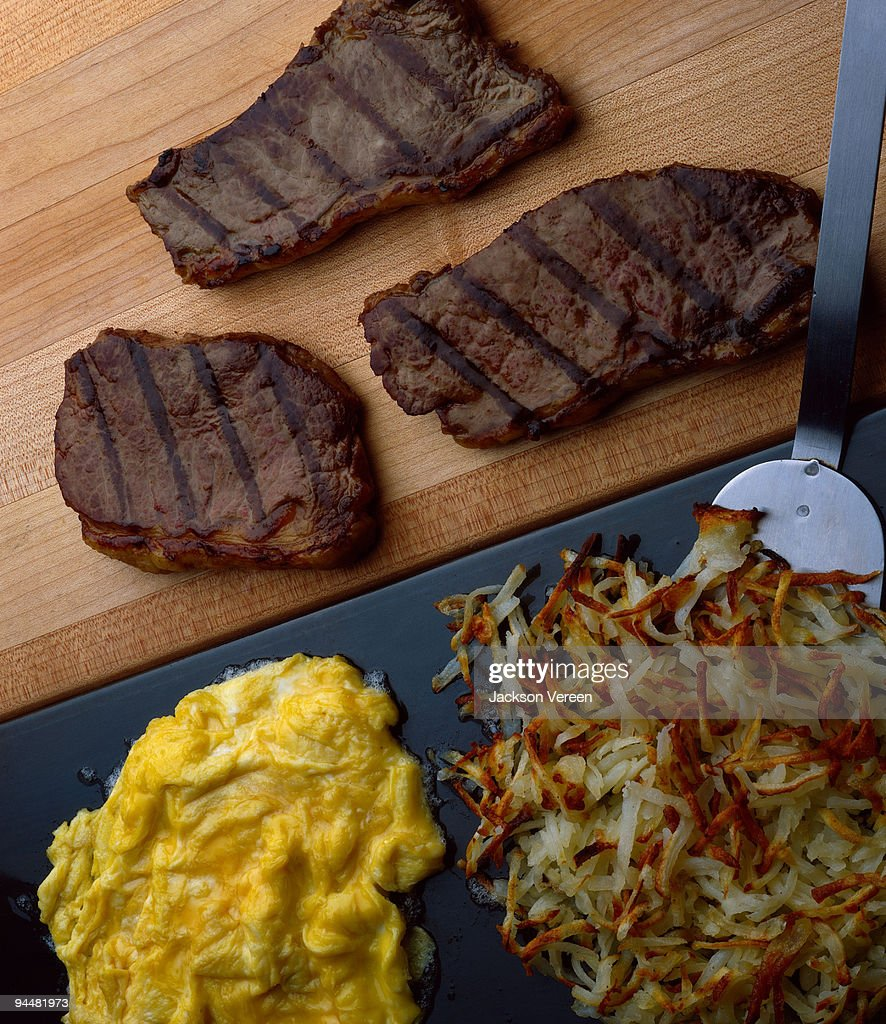 Steaks , eggs and hash browns : Stock Photo