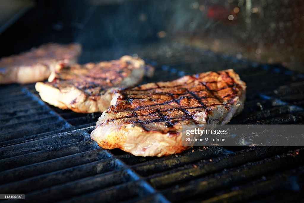 Steaks on the grill : Stock Photo