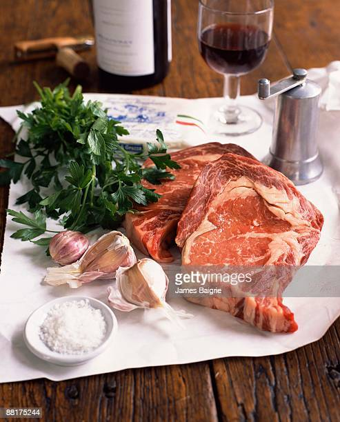 steaks with seasoning ingredients - flat leaf parsley stock photos and pictures