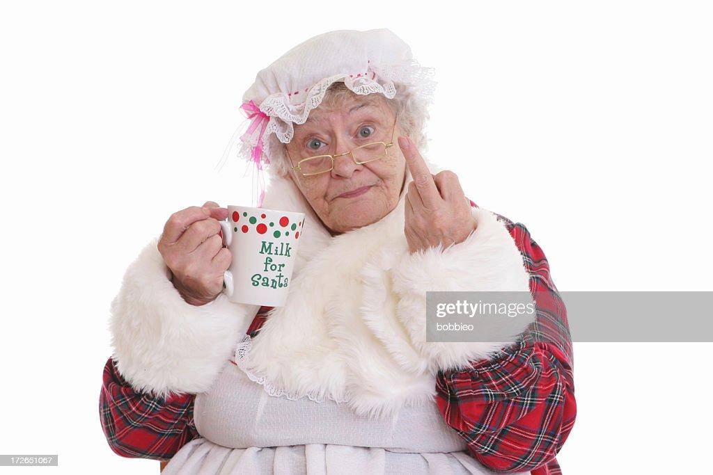 Stealing milk flip off Mrs Claus : Stock Photo