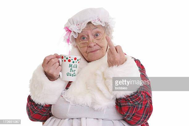 stealing milk flip off mrs claus - naughty santa stock photos and pictures