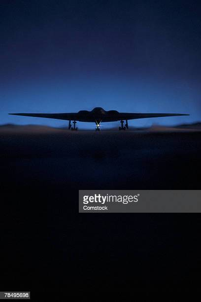 stealth bomber at night - stealth bomber stock photos and pictures