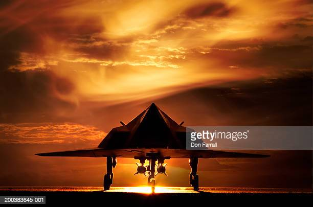 stealth bomber at sunset (digital composite) - stealth bomber stock photos and pictures